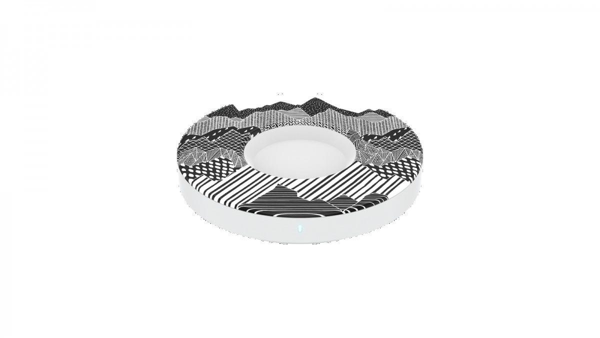 A PopSocket charger with mountainscape design and a cavity in the middle.