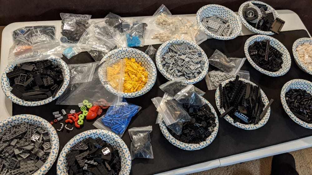 LEGO pieces arranged into bowls