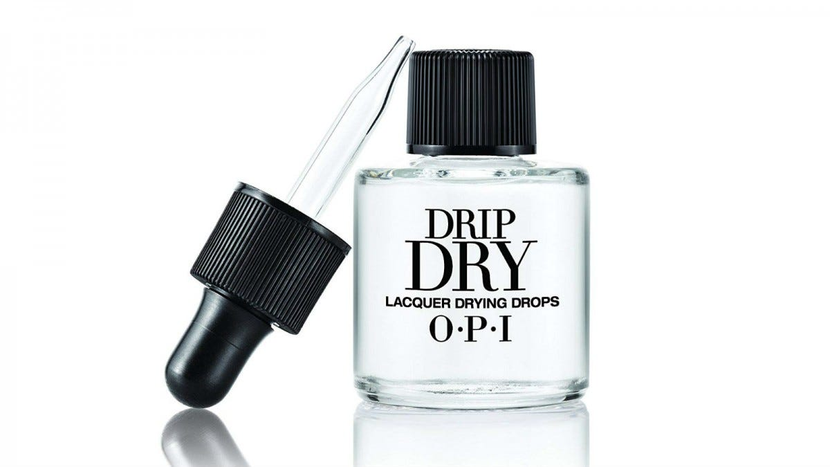 An eyedropper leaning against a bottle of OPI Drip Dry Drops.