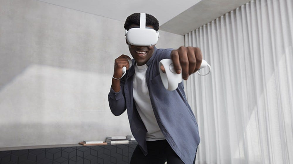 A man wearing a white oculus quest 2 headset