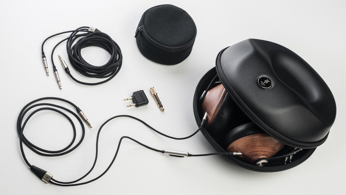 Image of headphones, carry case, cables and adapters