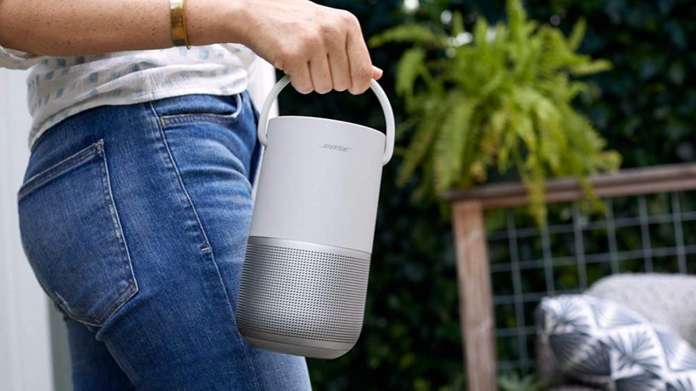 Person carrying Bose Portable Home Speaker