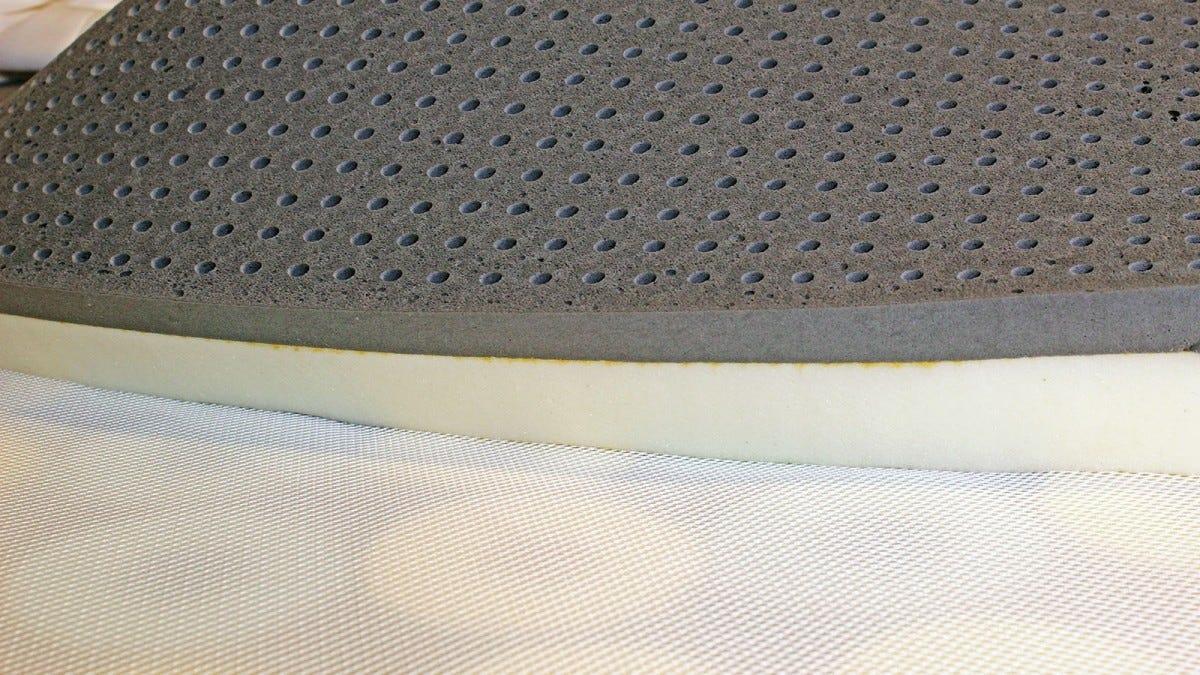 Two inches of white memory foam topped by a pitted dark grey latex layer.
