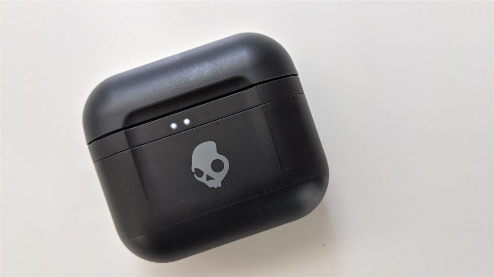 The Skullcandy Indy Fuel case with the charging indicator lights illuminated