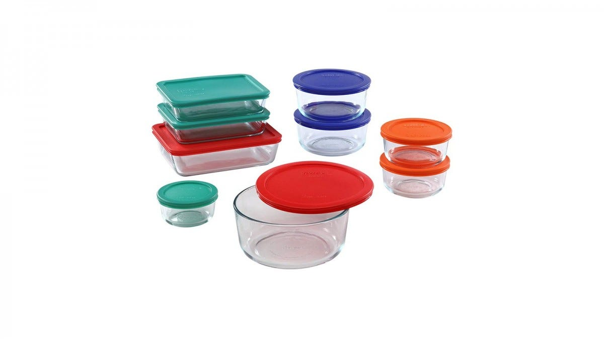 A set of glass food containers in rectangular and round shapes with lids.