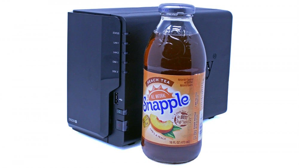 A DS220+ NAS next to a Snapple.