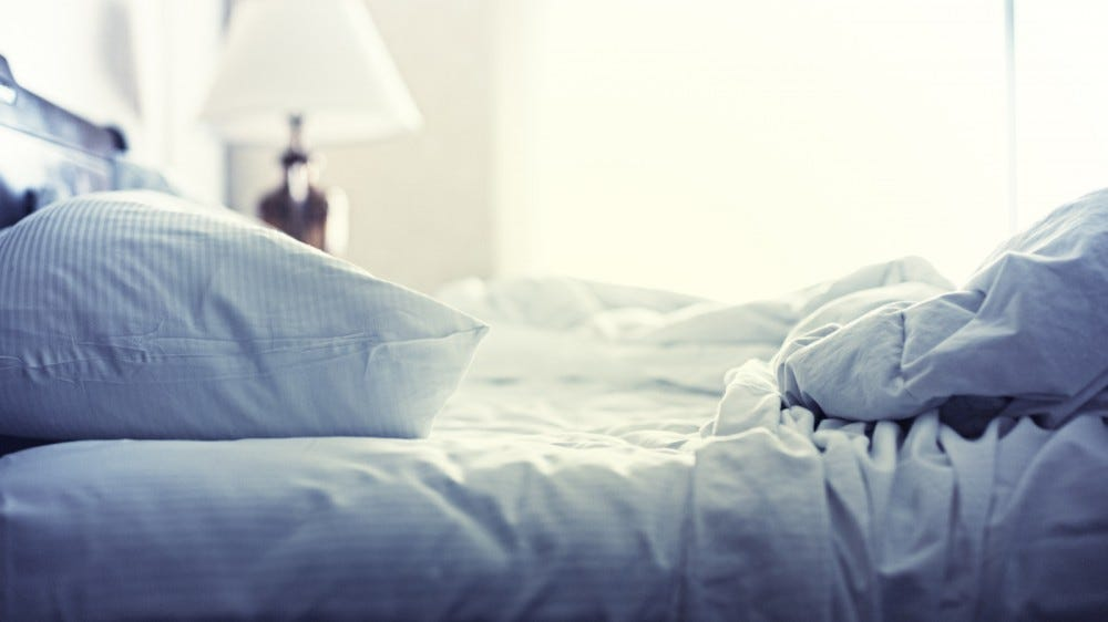 blue sheets with theme and pillows crushed after night's sleep