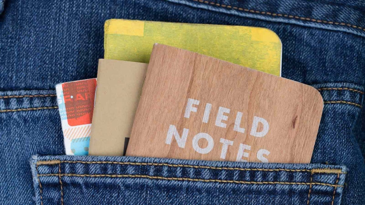 Field Notes brand notebooks in the rear pocket of a pair of jeans