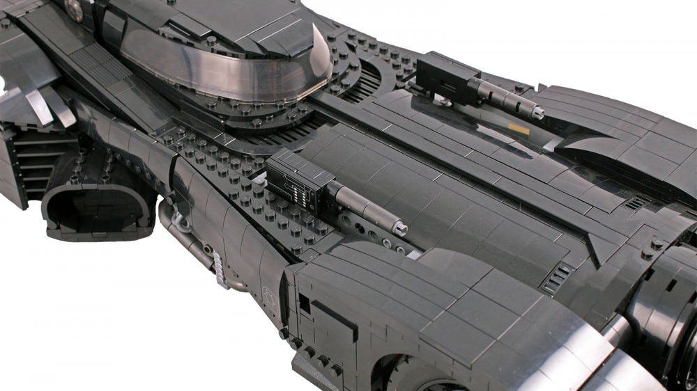 A closeup of the LEGO Batmboile with guns raised.