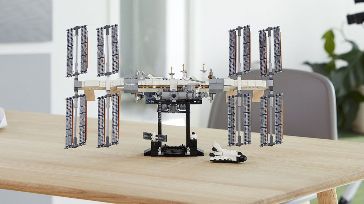 The LEGO International Space Station docked to a base on a table.