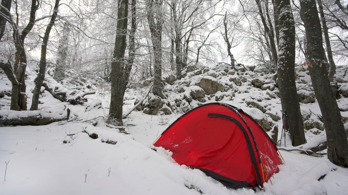 a bright red tent in a snowy landscape. It's beautiful.