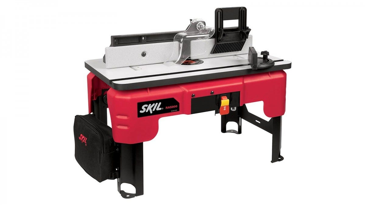 A SKIL RAS800 red router table with storage pouch.