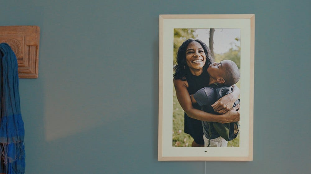 The Lenovo Smart Frame with a mother and son hugging.