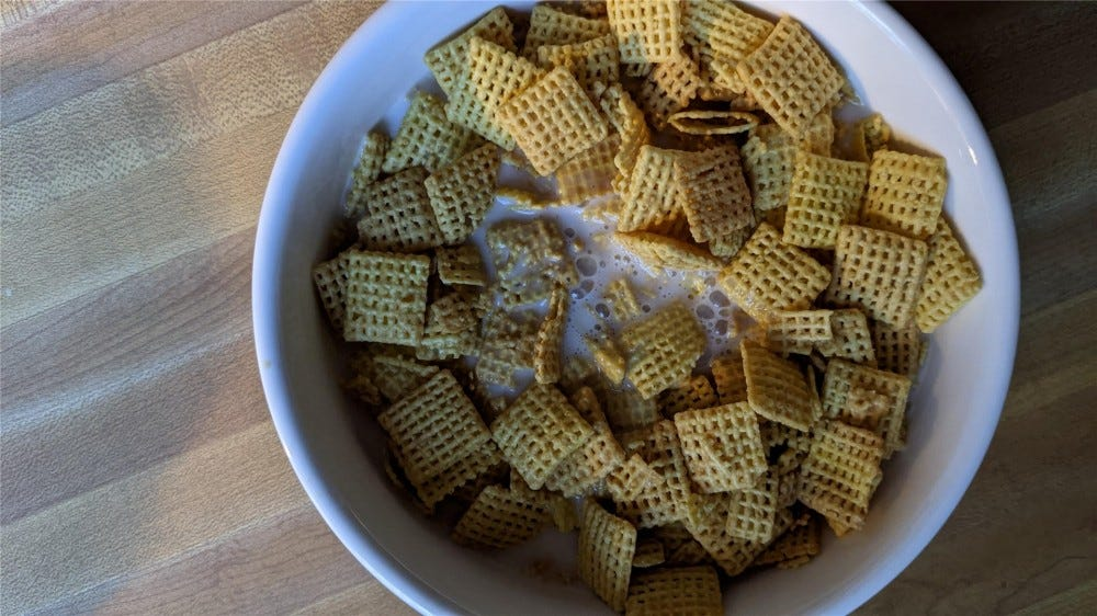 Peanut butter Chex in a bowl of almond milk