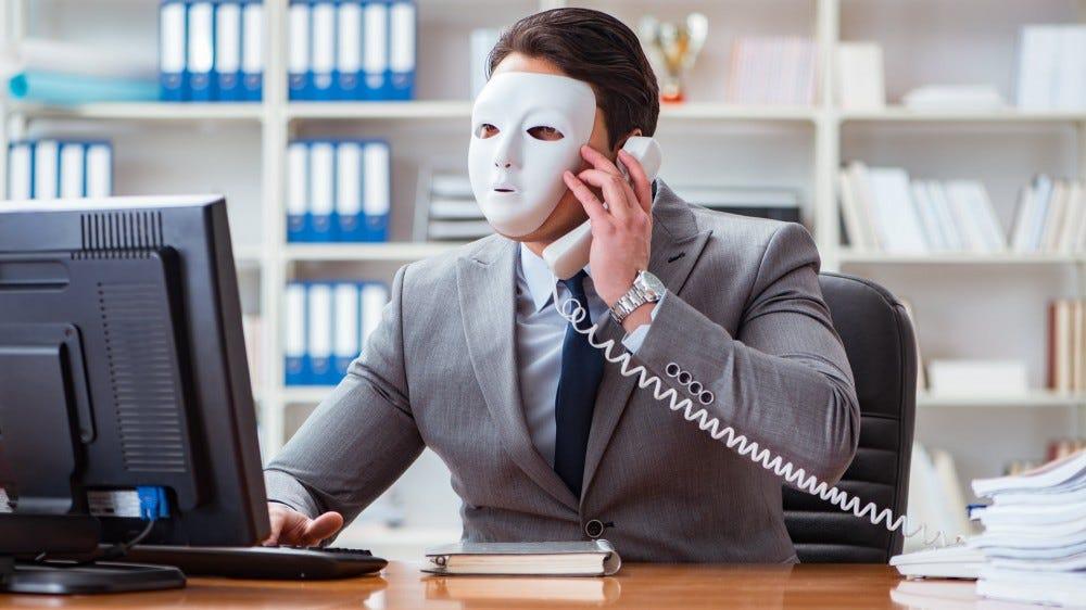 A man wearing a mask making a phone call.