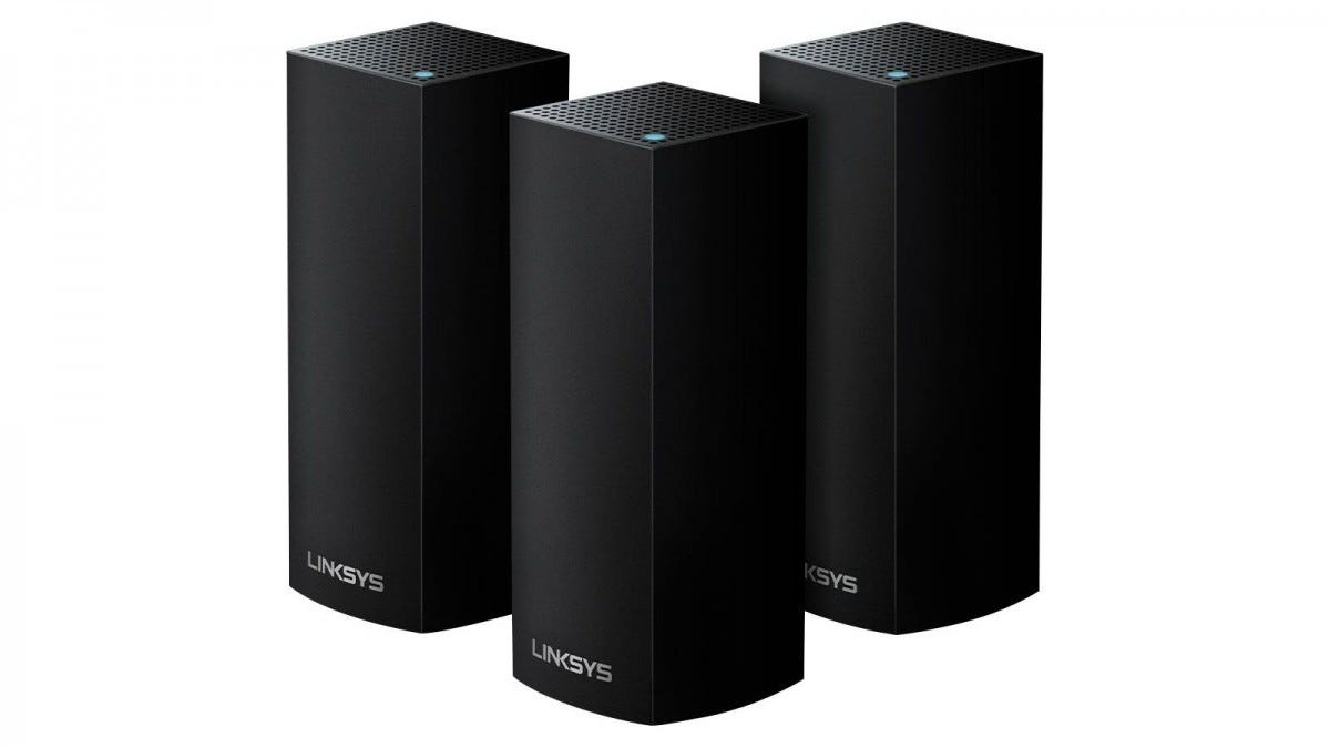 Three black Linksys Velop routers in a triangle formation.