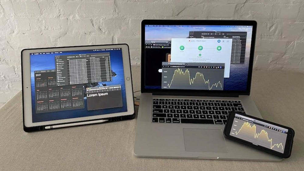 An iPad acting as a second screen for an older MacBook