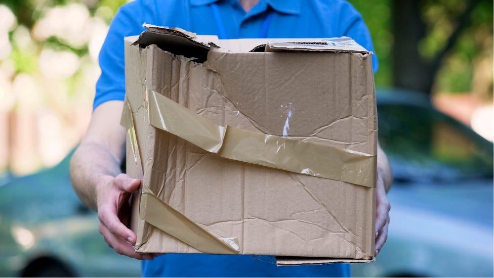 Courier showing damaged box