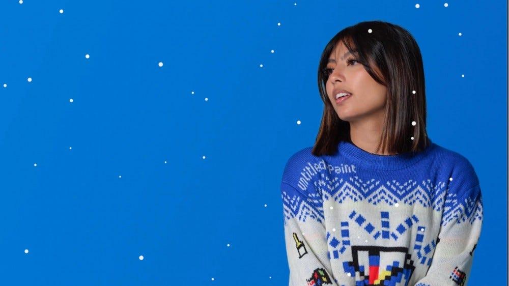 Girl wearing Microsoft Paint holiday sweater
