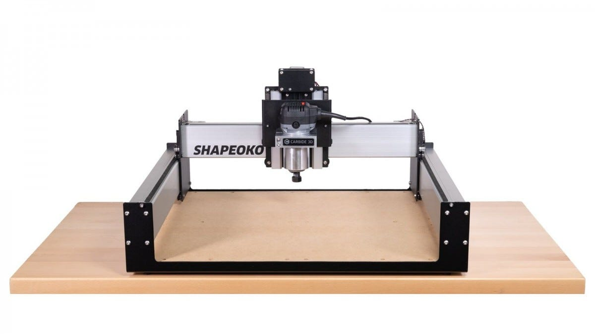 The Shapeoko 3 CNC machine sitting on a large wooden platform.