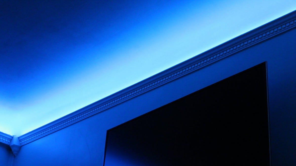 Blue light above crown molding.