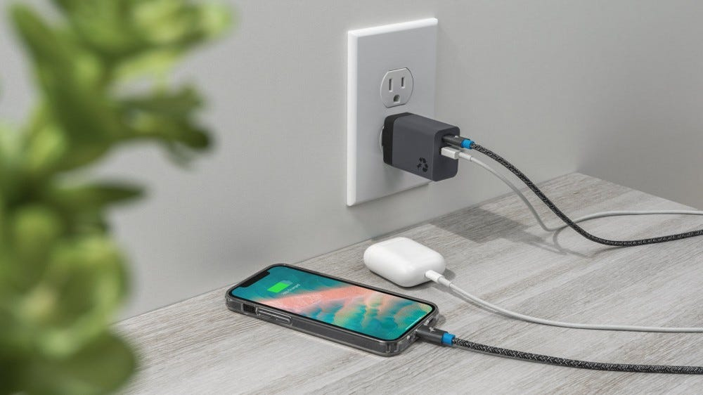 A Wally Mini plugged into both an iPhone and an AirPods case