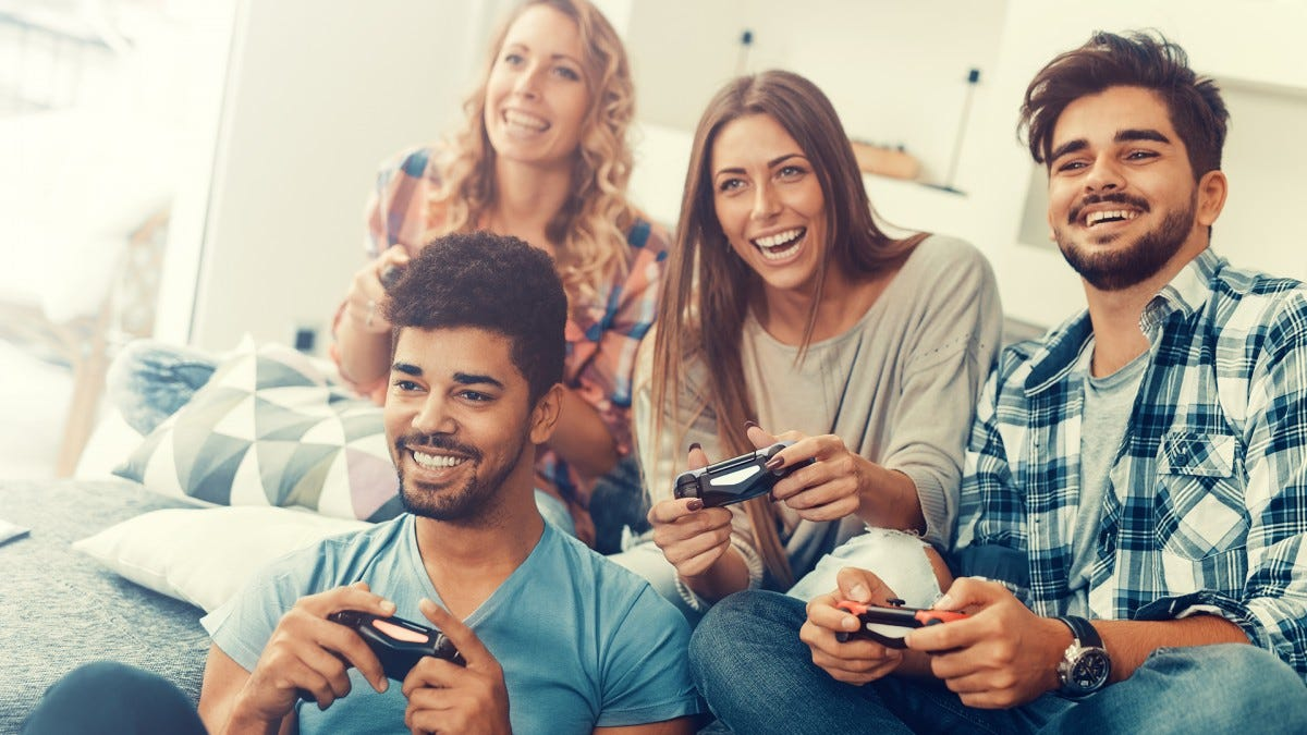 A group of friends playing games in beautifully vivid lighting.