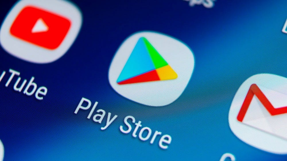 A closeup of a phone showing a Google Play Store logo.