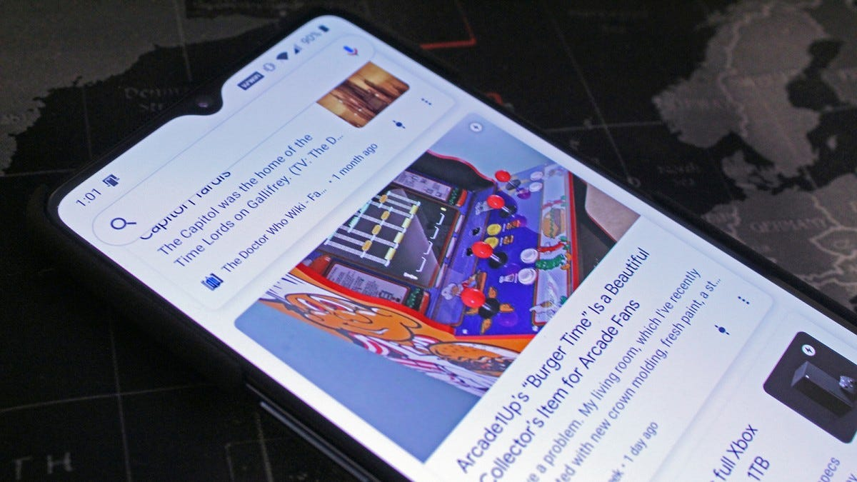 A closeup of the Review Geek Arcade1UP Burger Time review on a phone in Google Discover.