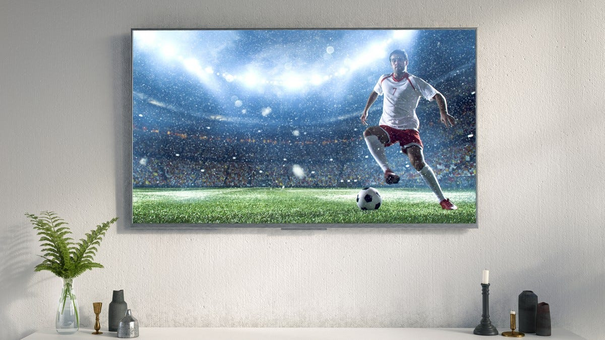 An impressive and expensive looking 8K TV hangs in a living room.