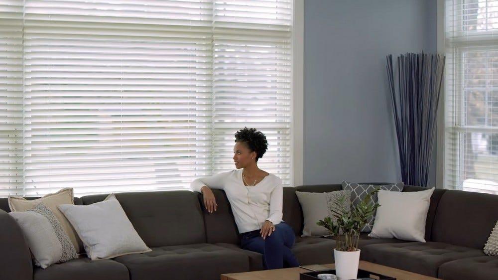 A screenshot from Lutron's wooden smart blinds advertisement.