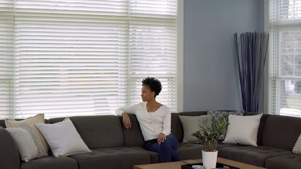 A screenshot from Lutron's wooden smart blinds advertisement.