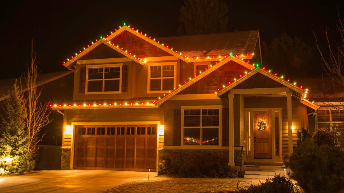 Christmas lights on the exterior of a two-story home.