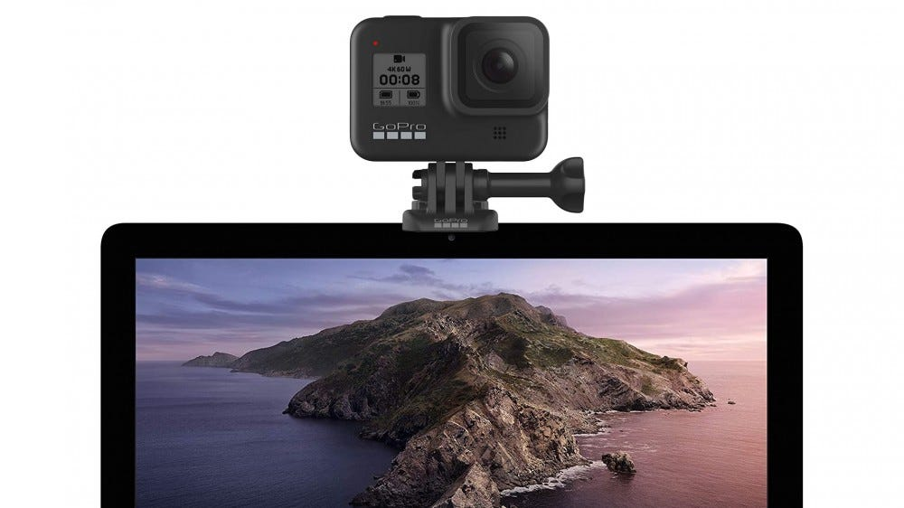 A GoPro Hero8 Black mounted on top of a Mac Pro.