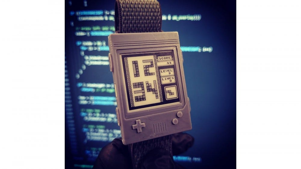 A photo of Watchy with a custom Tetris watch face and Gameboy case