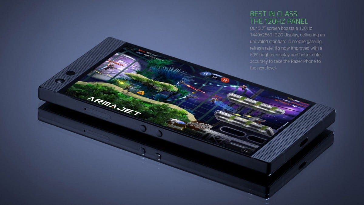 The Razer Phone 2 sitting on a table with a game on its screen.