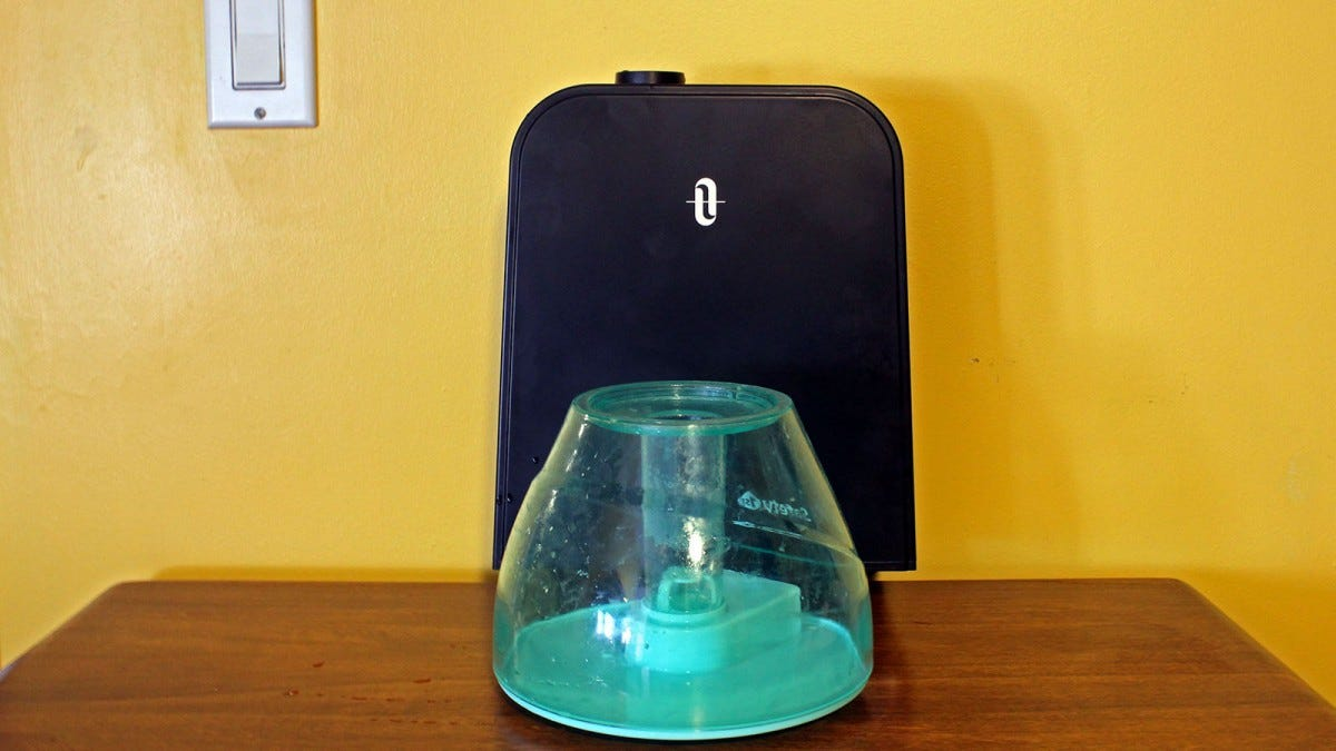 A small blue translucent tank in front of a large black opaque tank.