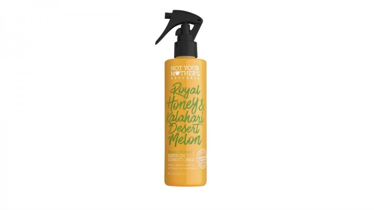 A spray bottle of Not Your Mother's Royal Honey and Kalahari Desert Melon Repair + Protect Leave-In Conditioner.