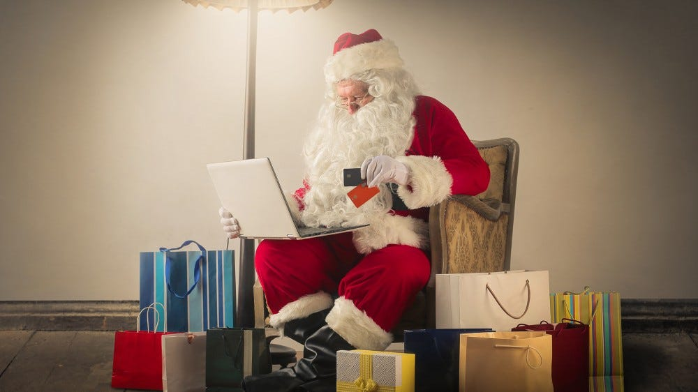 Santa shopping on his laptop.