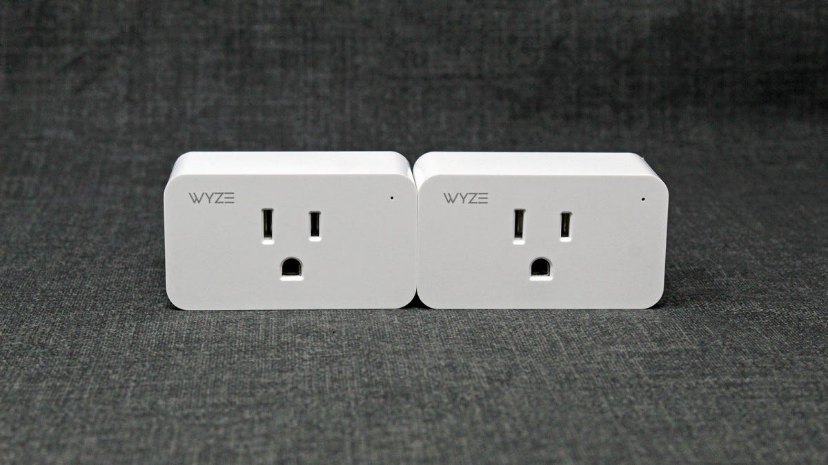Two Wyze Plugs side by size, with the Wyze logo showing.