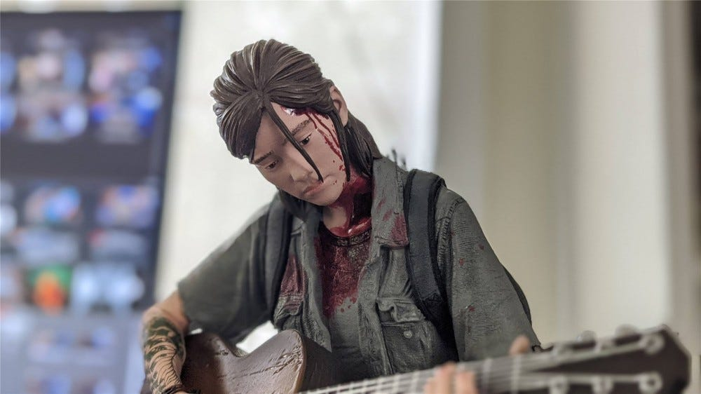 A portrait shot of the Ellie statue in The Last of Us Part II Collector's Edition box