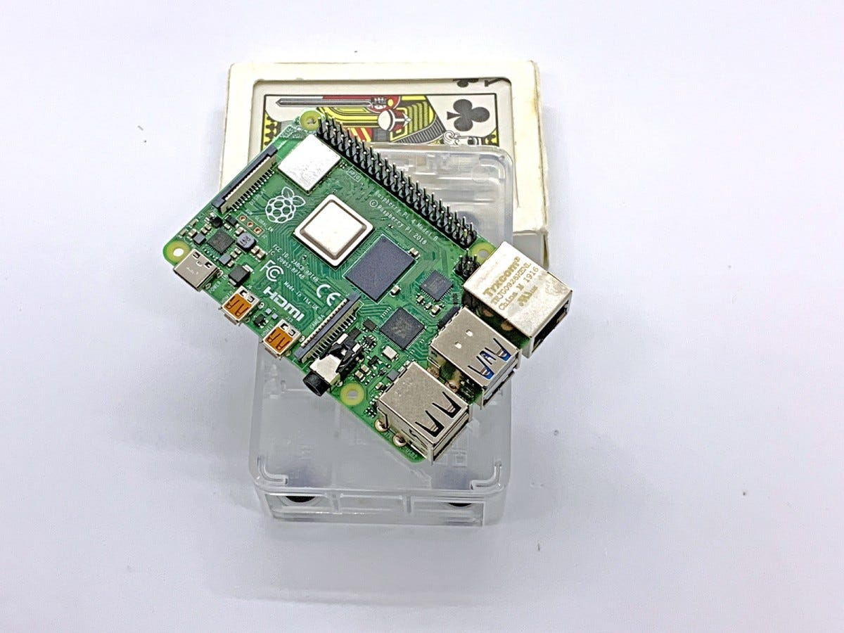 The Raspberry Pi sitting on top of a deck of cards.