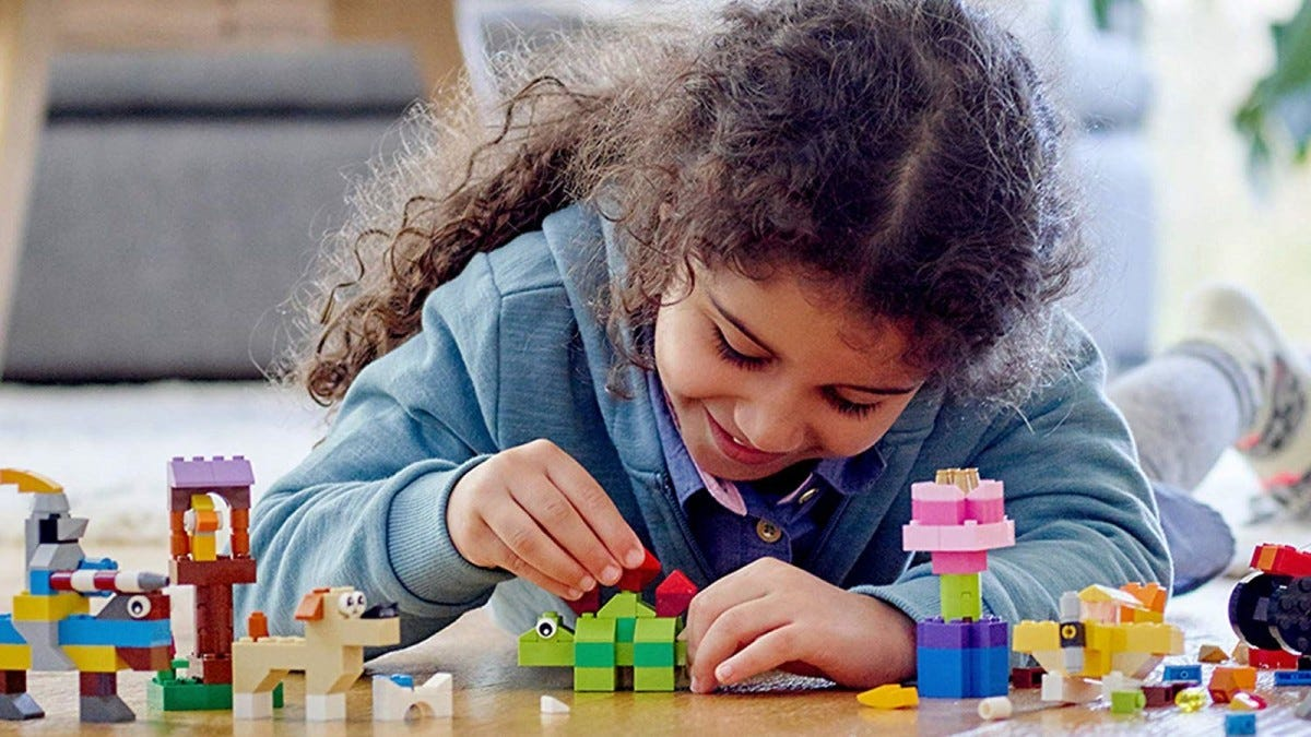 A young girl playing with LEGO bricks.