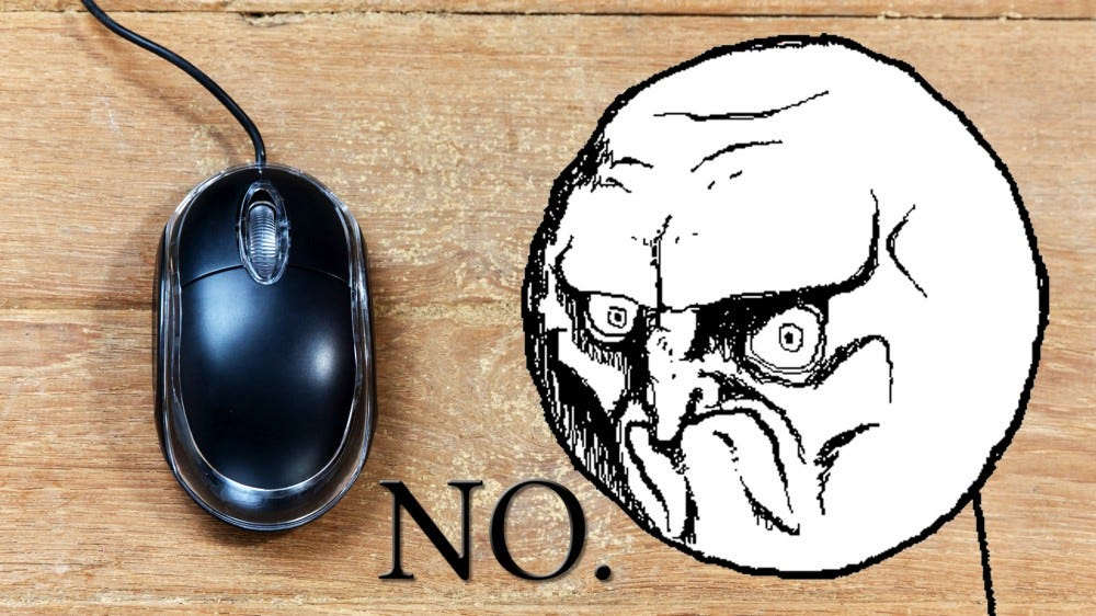 """A photo of a mouse on bare wood, with the """"NO"""" rage face to the right."""