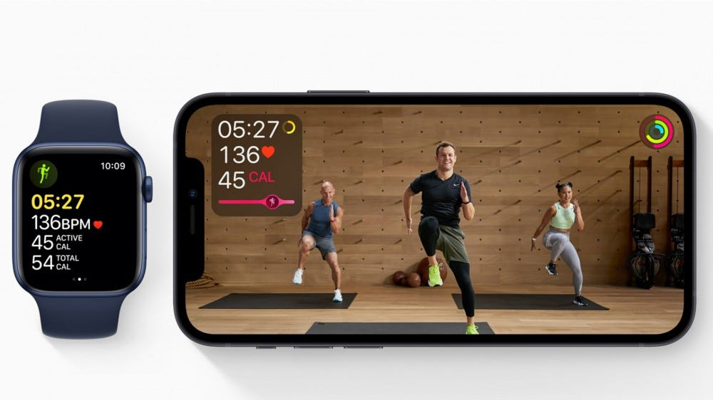Apple Fitness + video with Apple Watch next to it with active workout