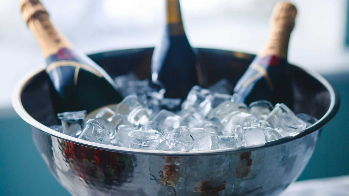 Bottles of champagne in a tub of ice