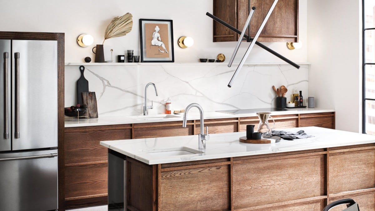 Two U by Moen Faucets with large curves and square handles.