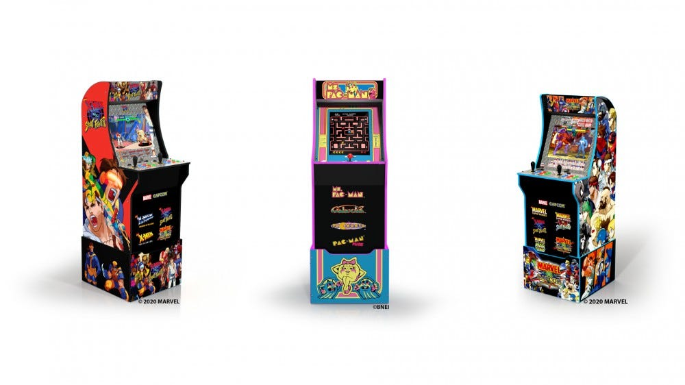 Ms. Pac-Man, X-men vs. Street Fighter, and  Marvel vs. Capcom 3/4th scale cabinets standing in a row.