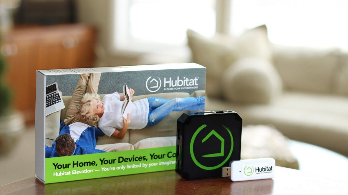 A Hubitat Hub, USB stick, and Box in a living room.