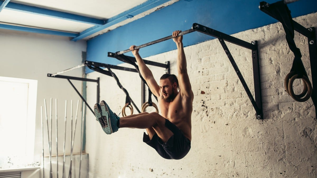 A man on a pull-up bar